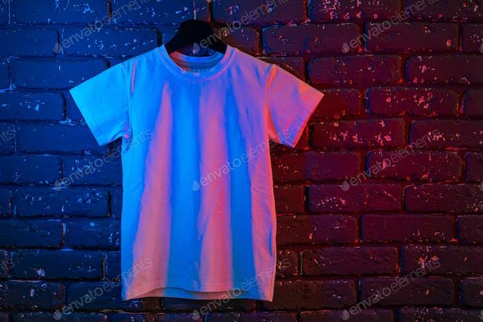 White color unisex t-shirt in neon light