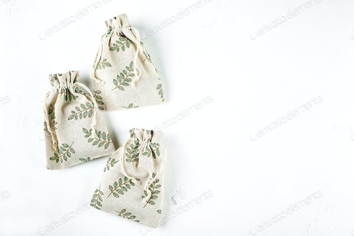 Gift Wrapping Holiday Season Eco-friendly Zero Waste Lifestyle. Textile pouches on white background