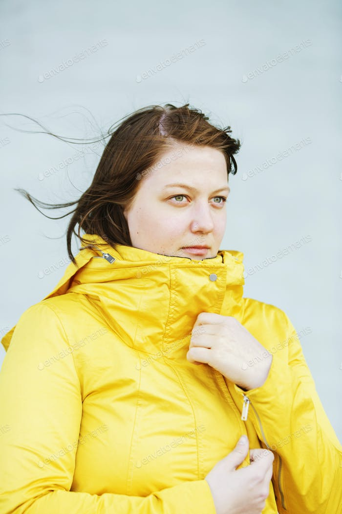 Young woman in raincoat