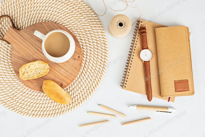 Styled minimal desktop mockup with organic color stationary, coffee cup
