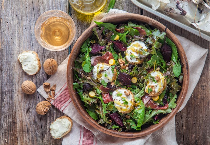 Beet and goat cheese salad in a pot, rustic style