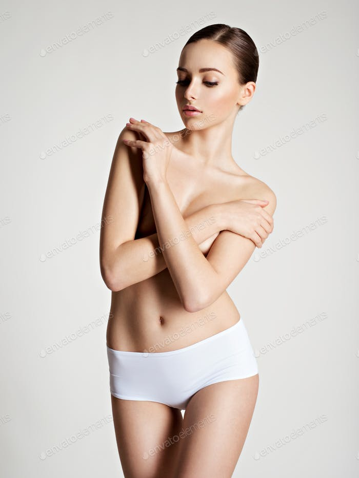 Beautiful woman with perfect body posing at studio