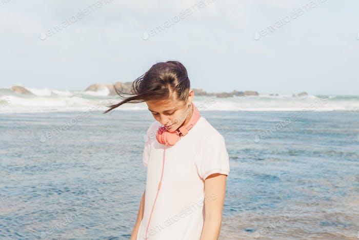 Woman walking on the beach sand