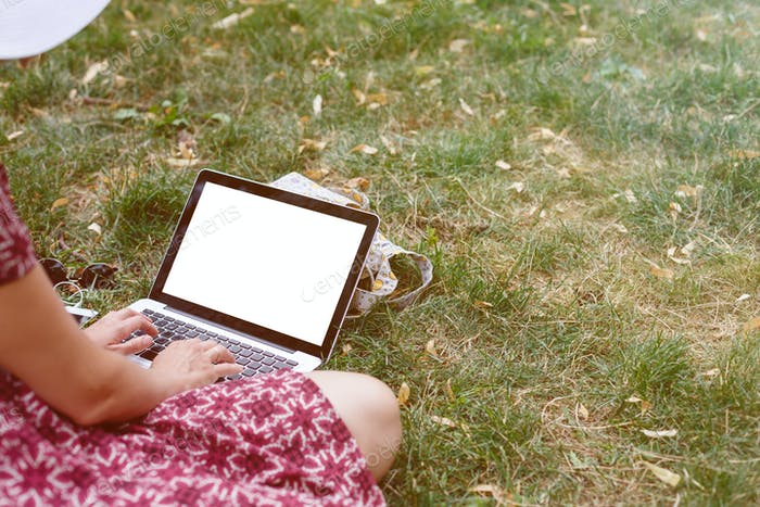 Crop top view of woman using laptop