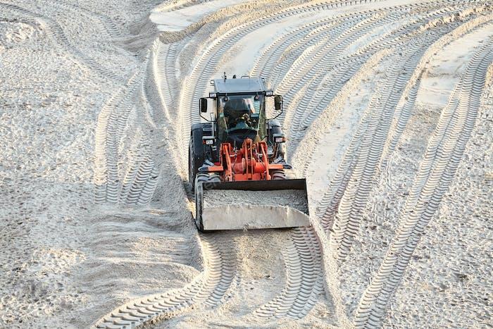 Bulldozer at work on a beach
