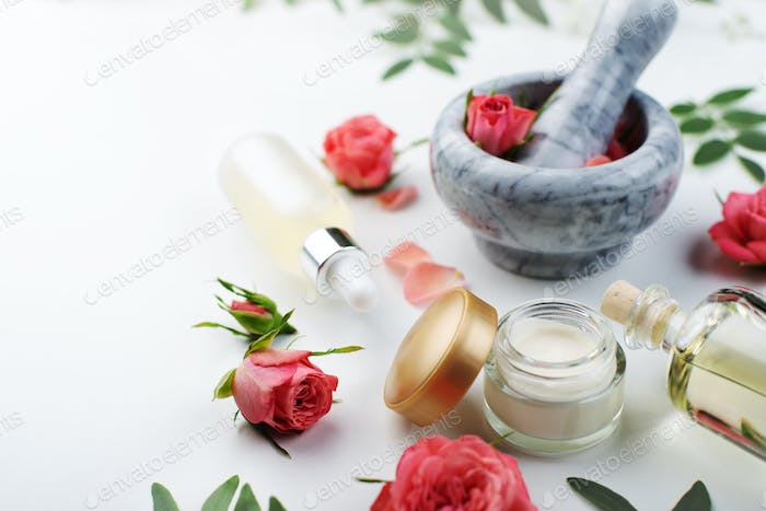 Handmade rose cosmetics concept of mortar and pestle with rose buds