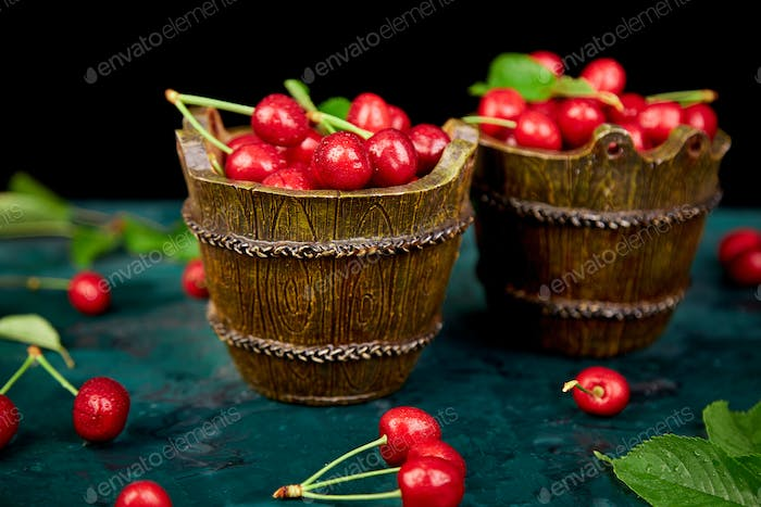 Red cherry in green bowl