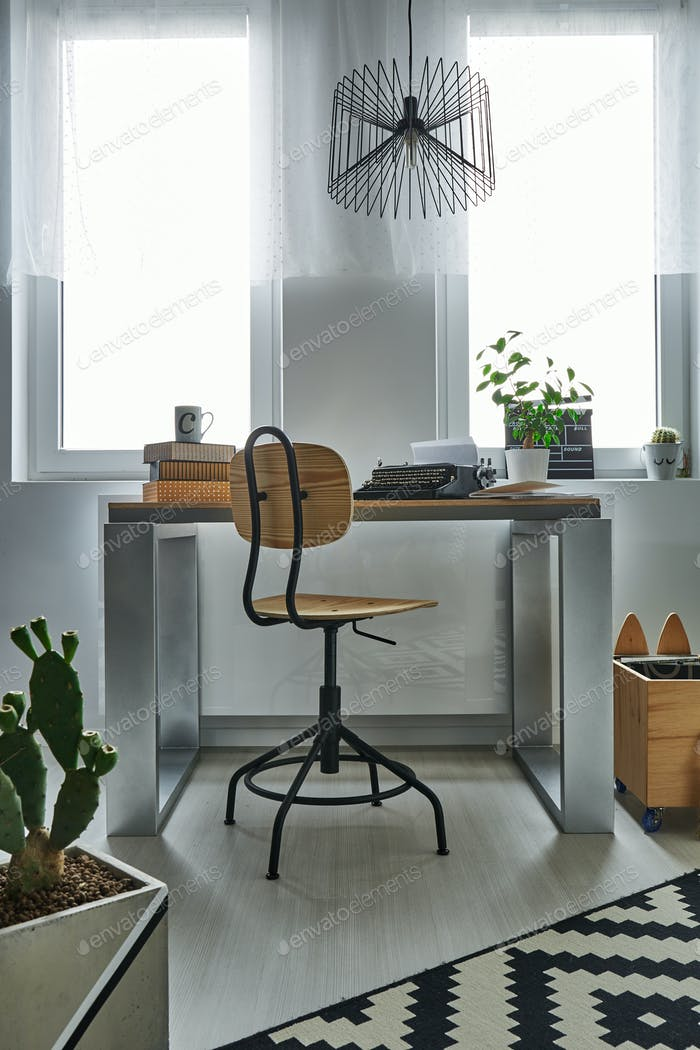 Simple desk and wooden chair