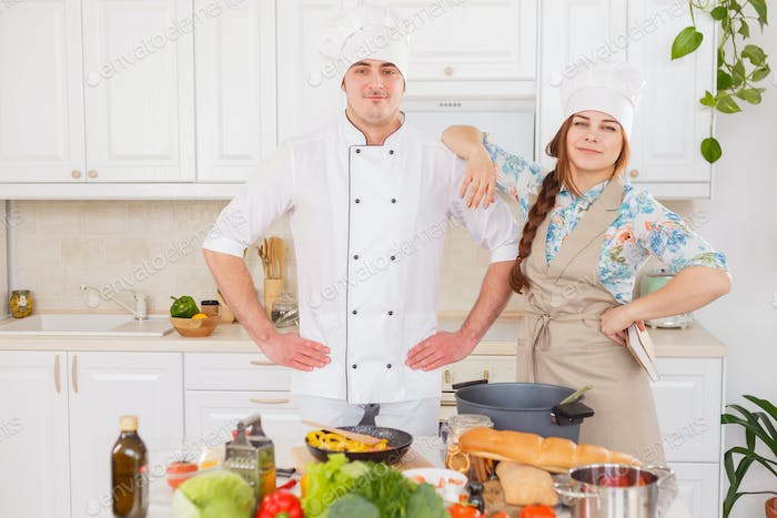 Chef and his student cook in the kitchen