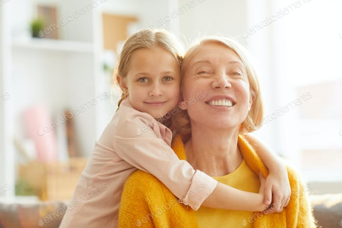 Cute Girl Embracing Grandma