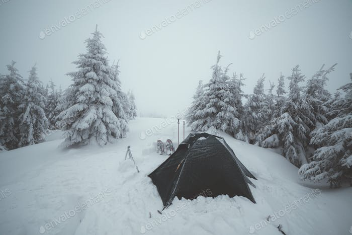 Frozen tents in the high mountain