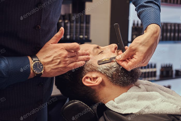 Master hairdresser and client in a hairdressing salon.