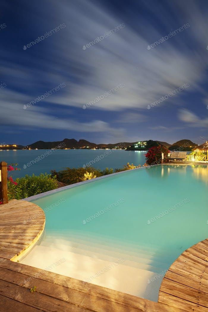 Pool And Caribbean Sea At Night, Antigua