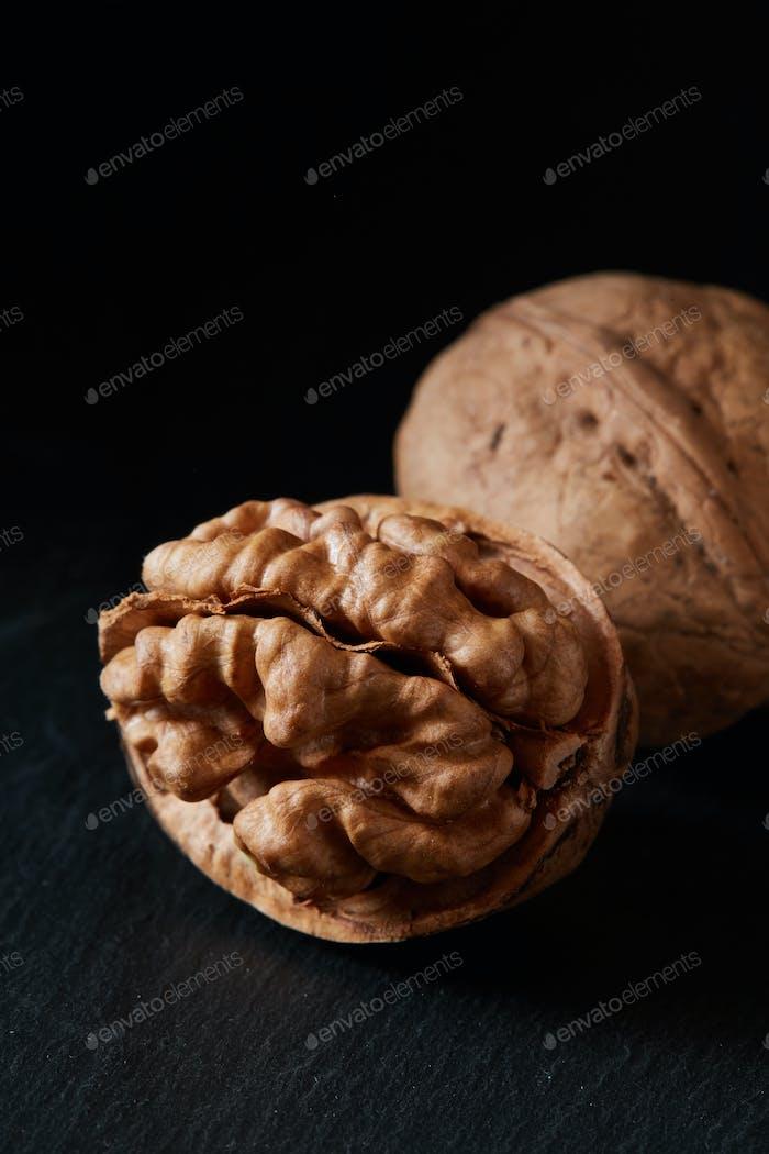 Walnut and kernel on a slate backdrop