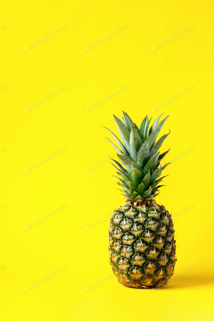 Pineapple on brightly yellow background. Minimal style. Food Idea .Summer concept.