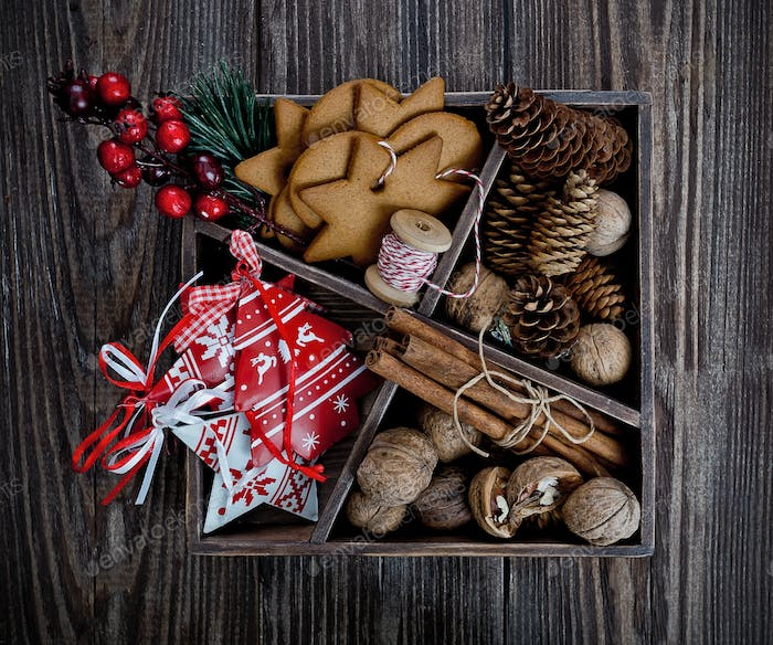 Christmas decoration box over the wooden background
