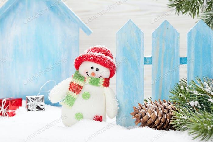 Christmas snowman and fir tree