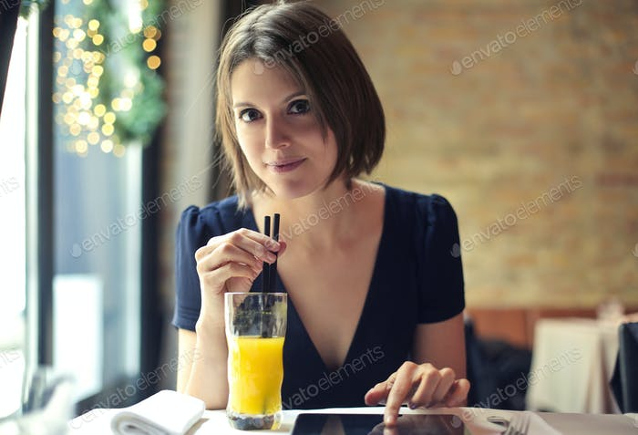 Girl drinking a juice
