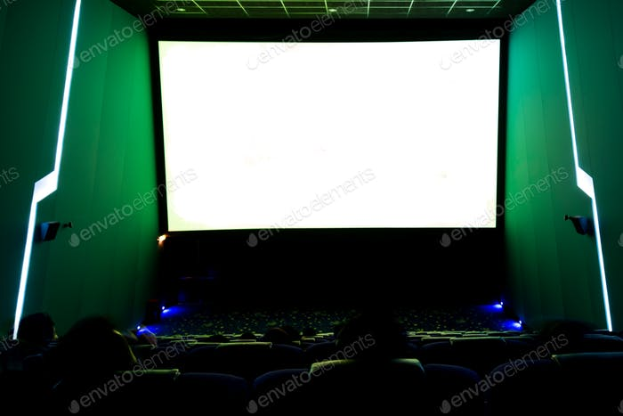 Viewers watching movie at cinema with screen isolated in white long exposure