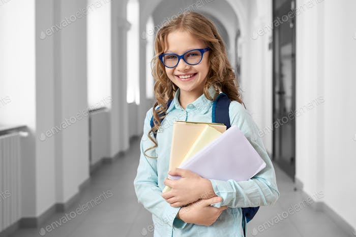 Blonde school girl colorful notes and books