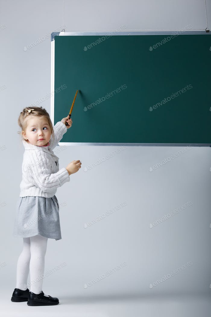 cute little girl with blackboard