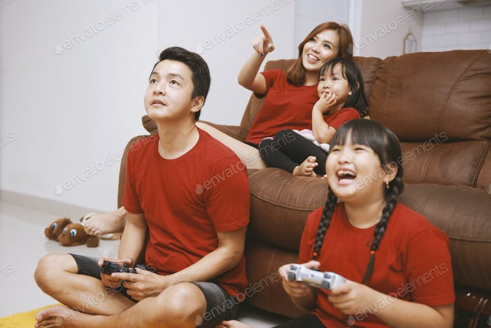 Happy Asian Family Playing Together