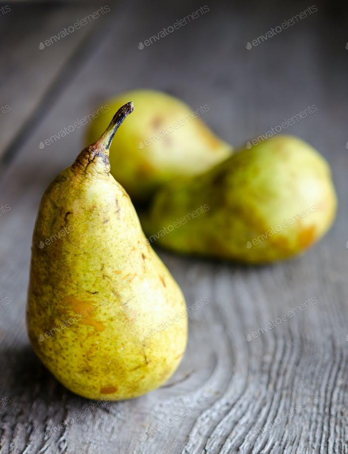 Yellow pears in a row
