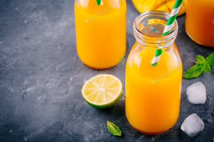 Mango orange lemonade with ice and lime