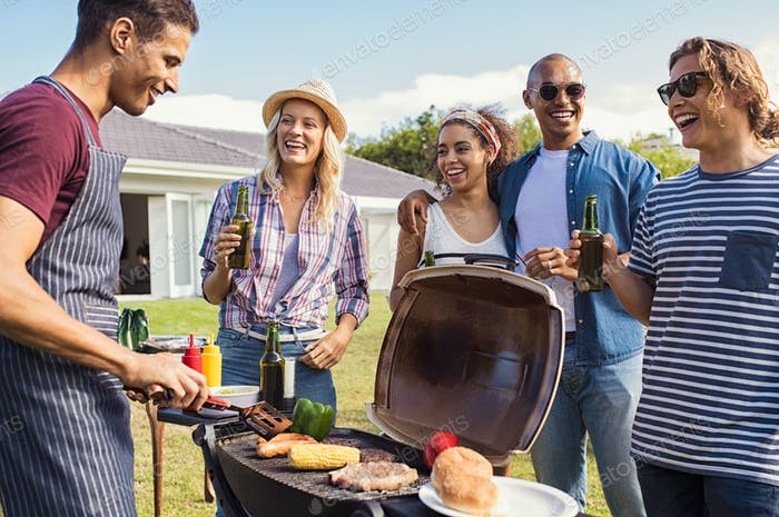 Friends enjoying party with bbq