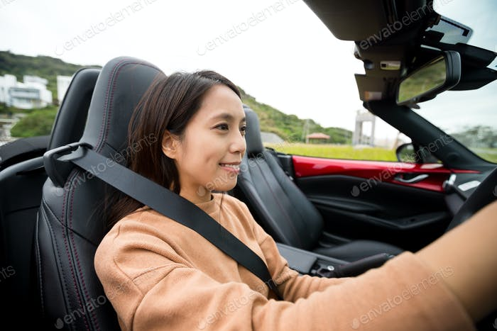 Woman driving a convertible sports car