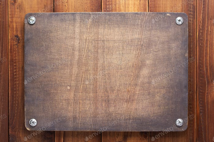 nameplate at  wooden background with screws