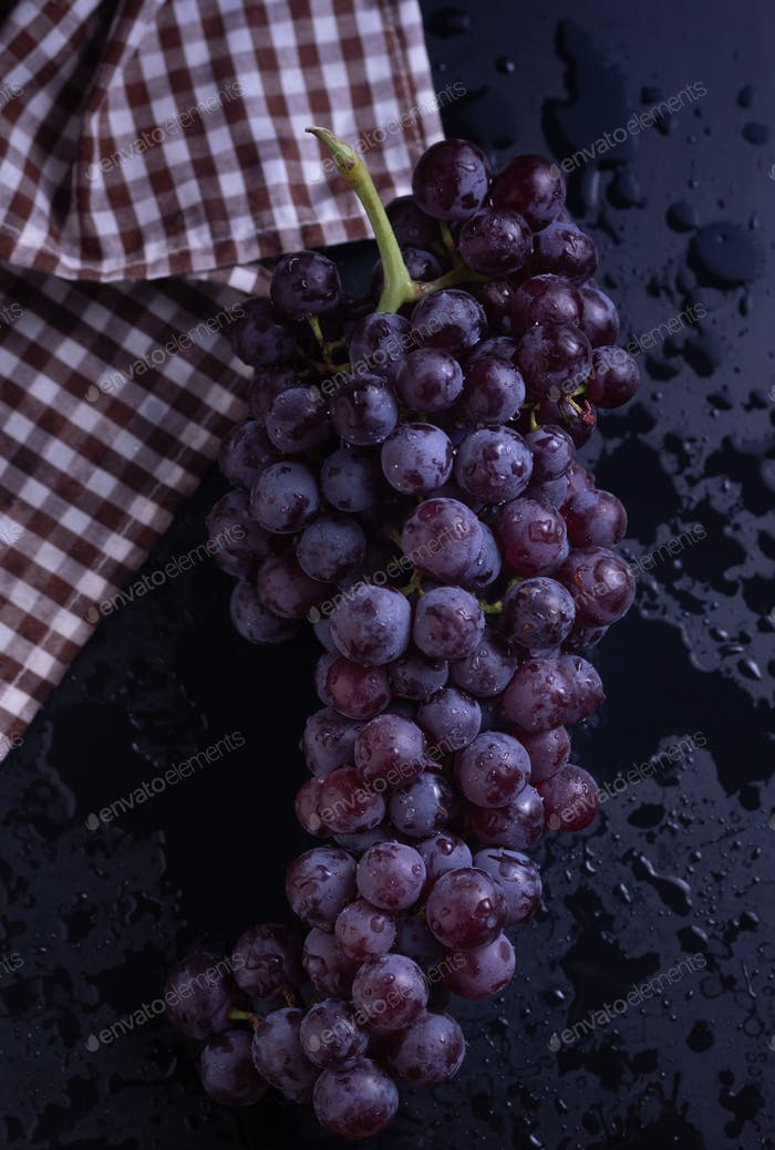 A bunch of table grape on table