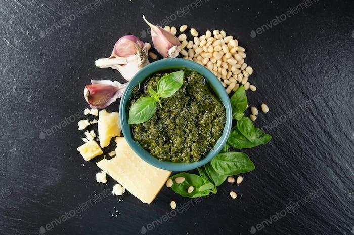 Flat lay view at green bowl with genovese pesto sauce