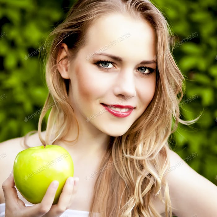 Thumbnail for portrait of a beautiful girl with an apple