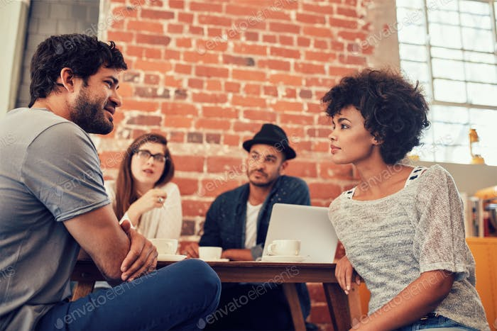 Young people meeting at a coffee shop