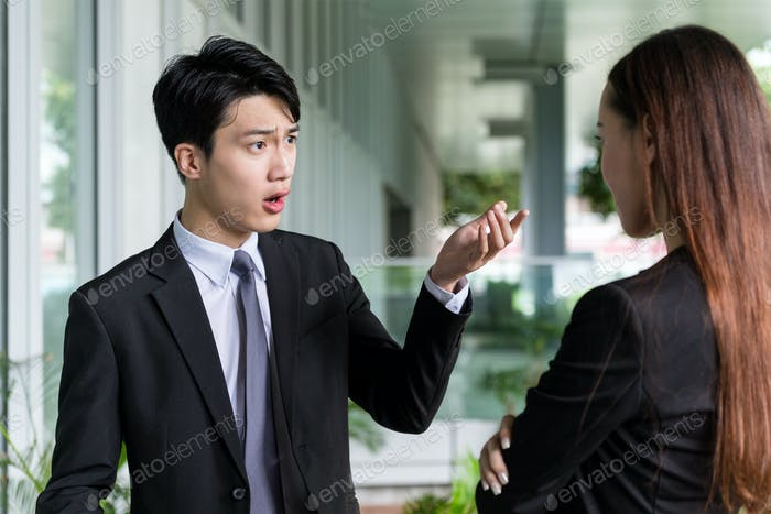 Businessman argue with his assistant