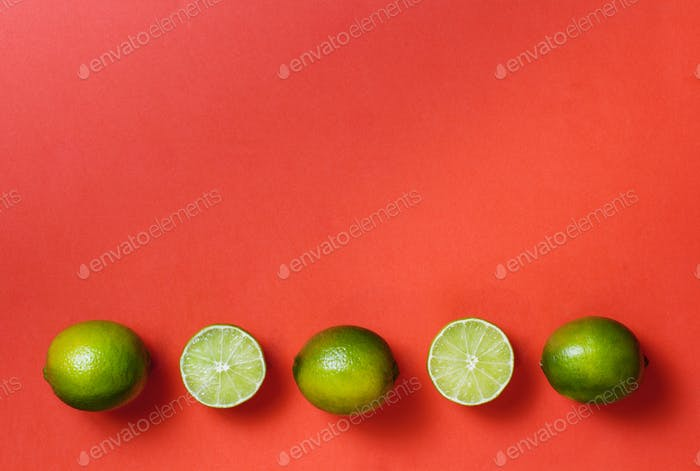 Limes on a coral red background