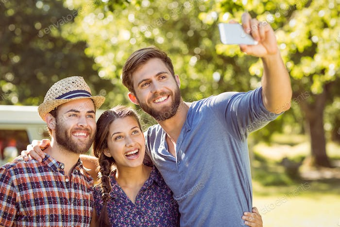 Hipster friends taking a selfie on a summers day