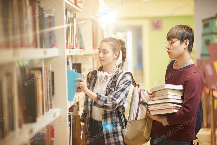 Students taking books for homework