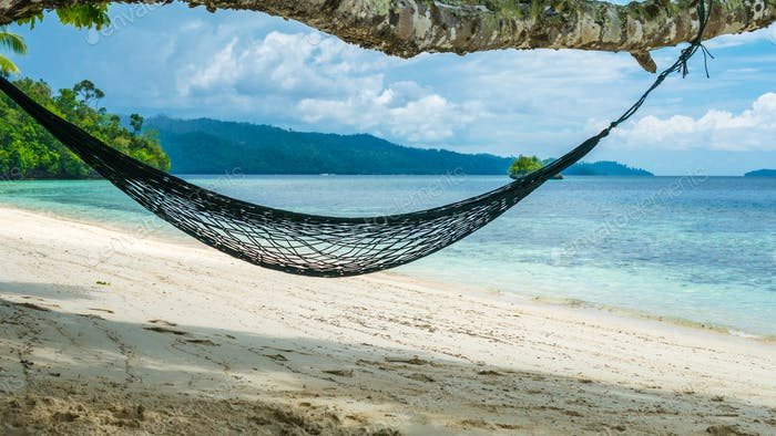 Hammock on the Beach, Batu Lima, Coral Reef of an Homestay Gam Island, West Papuan, Raja Ampat