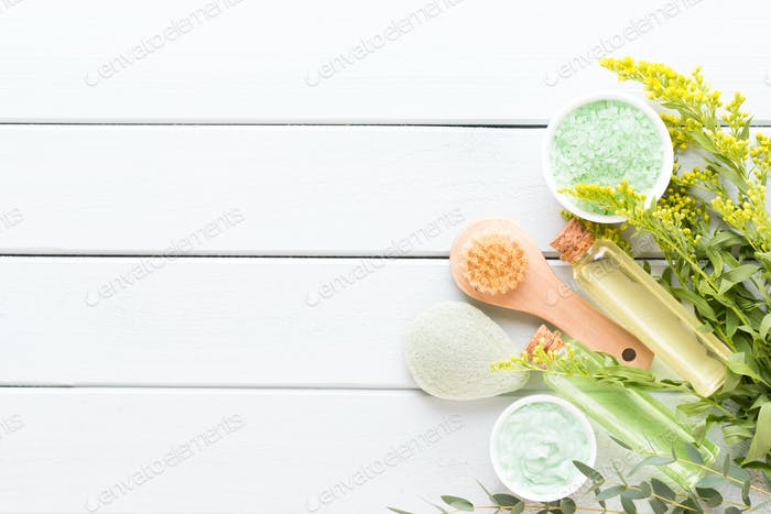 Beauty and aromatherapy concept with spa set on pastel rustic wooden background.