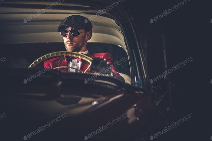 Elegant Vintage Car Driver