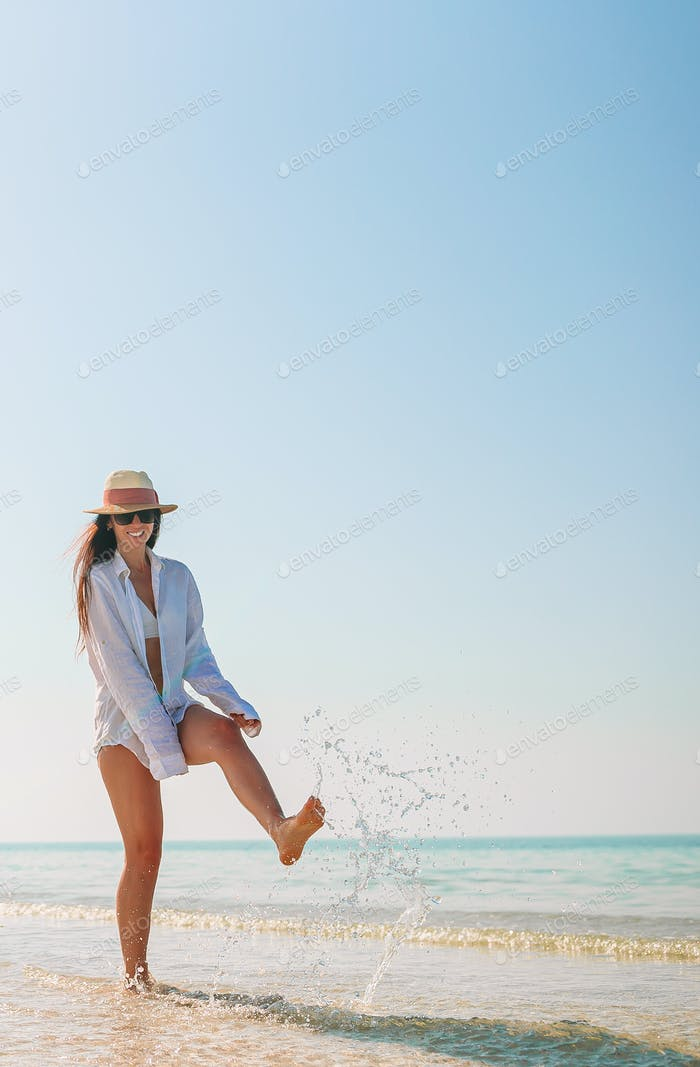 Woman on the beach during caribbean vacation