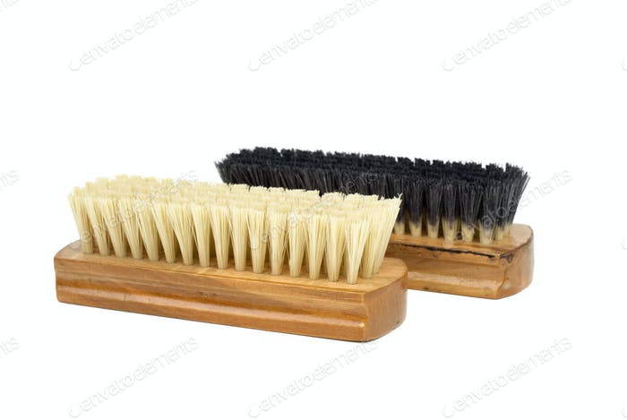 Dirty (black) and new (white) clothes (or shoe) brushes