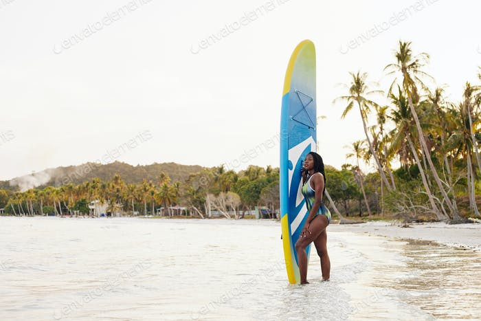Woman with sup surfing board