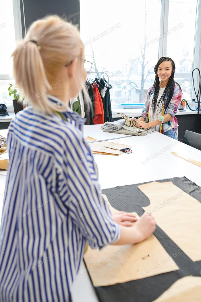 Fashion designers working in atelier