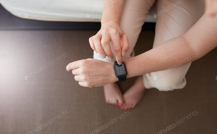 Female hands using smartwatch