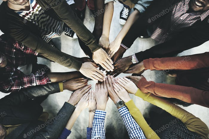 Aerial view of diverse people stacking hands in the middle