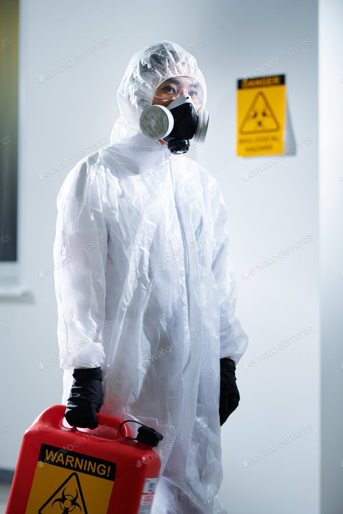 Laboratory worker in biohazard suit