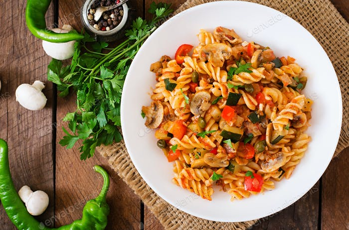 Vegetarian Vegetable pasta Fusilli with zucchini, mushrooms and capers